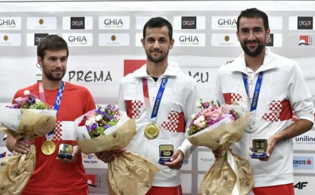 Čilić, Pavić i Mektić s medaljama stigli u Hrvatsku
